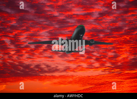 computer graphic silhouette commercial jet aircraft taking off background brightly colored clouds at sunset Altocumulus - Stock Photo