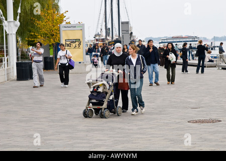 Multicultural crowd at the Toronto Habourfront Ontario lakeshore - Stock Photo