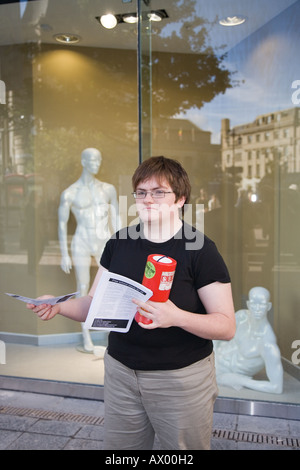 Dundee city, Scotland UK,  Overgate shopping centre and mall where young socialist is giving out recruiting leaflets. - Stock Photo