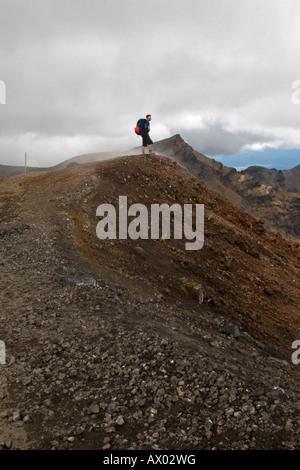 Male Hiker Stood on Top of Ridge, Tongariro - Stock Photo