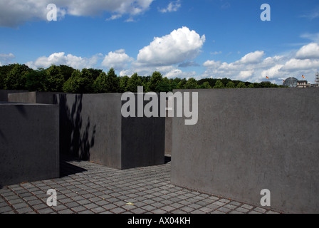 Monument to the murdered jews of Europe with German parliament in the background, berlin, germany. - Stock Photo