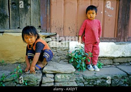 Two young girls, Annapurna district, Himalayas, Nepal, Asia - Stock Photo