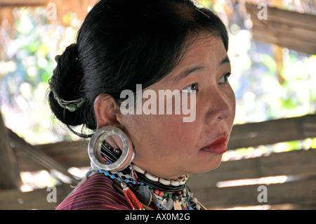 Padaung or Kayan (ethnic minority) woman wearing large earrings, Thailand, Southeast Asia, Asia
