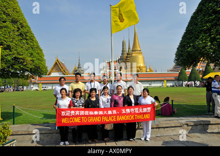 Asian tourist group in front of Wat Phra Kaeo Grand Palace (Temple of the Emerald Buddha), Bangkok, Thailand, Southeast - Stock Photo
