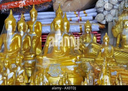 Buddha statues for sale along Bamrung Muang Road, Bangkok, Thailand, Southeast Asia - Stock Photo
