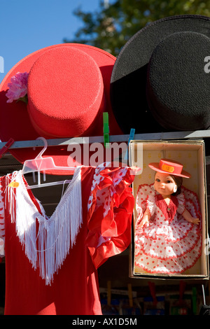 Souvenirs, hats, doll in flamenco dress, Sevilla, Andalucia, Spain - Stock Photo