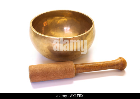 Traditional Tibetan singing bowl and wooden mallet - Stock Photo