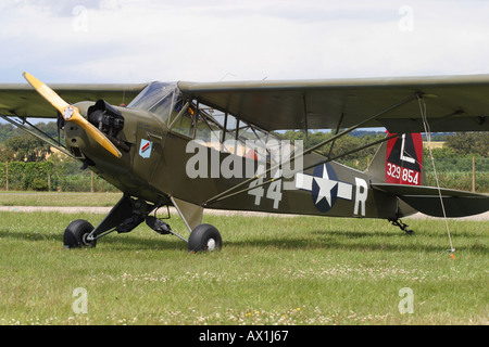 Piper Cub L-4 vintage warbird World War 2 US Army observation spotter plane - Stock Photo