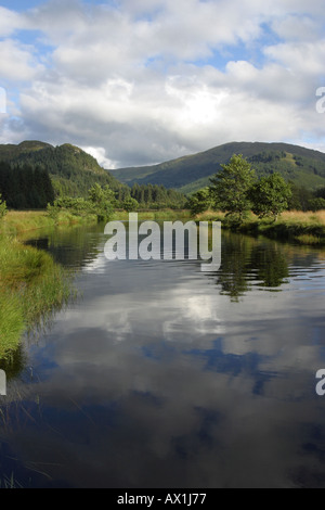 River Polloch still water flows to Loch Shiel with Beinn Resipol behind - Stock Photo