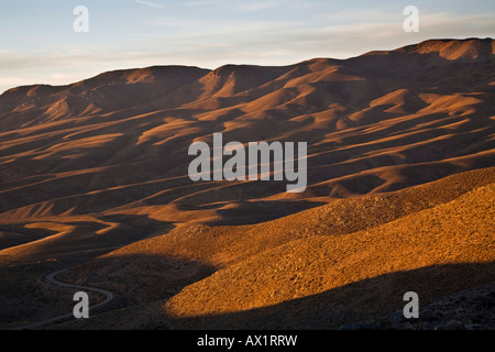 Hill landscape in the first morning light, Central Andes, Argentina, South America - Stock Photo