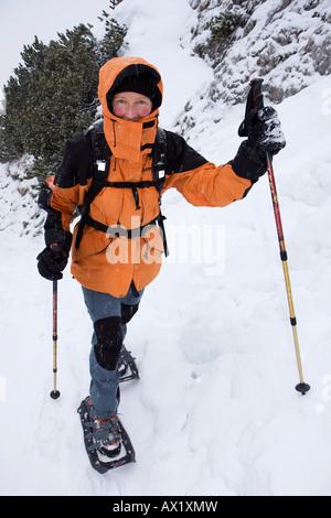 Snowshoer near Tegernsee Lake, Bavaria, Germany, Europe - Stock Photo