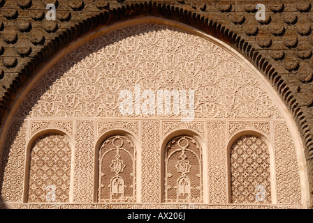 Oriental windows with fine stucco richly decorated Medersa Ali Ben Youssef medina Marrakech Morocco - Stock Photo