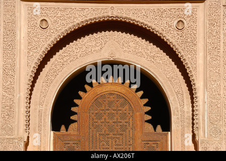 Oriental portal made of cedar wood with fine stucco richly decorated Medersa Ali Ben Youssef medina Marrakech Morocco - Stock Photo