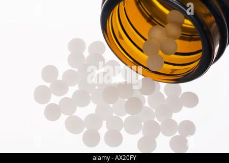 Globuli, homeopathic healing - Stock Photo