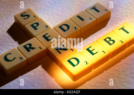 SCRABBLE BOARD GAME LETTERS SPELLING CREDIT SPEND DEBT - Stock Photo