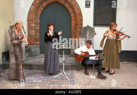 Traditional chamber music in front of Three Brothers Riga Latvia - Stock Photo