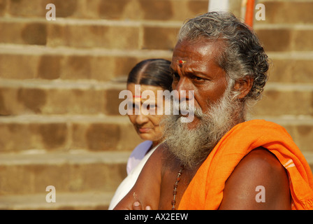 An indian poojari and his wife standing in frint of pdmanabha temple trevandrum before the attukalPONGALA - Stock Photo