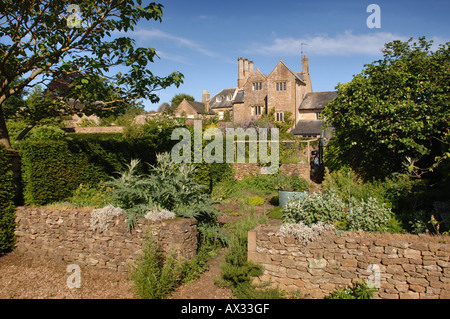 A HERB GARDEN RETAINED BY A DRY STONE WALL AT MANOR FARM SOMERSET BY GARDEN DESIGNER SIMON JOHNSON UK - Stock Photo