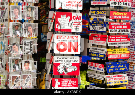 postcards and tacky comical gifts on sale at a seaside shop gift traders at the seaside in england - Stock Photo