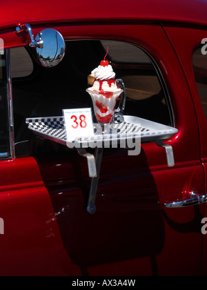 Stock Photo of a tray with a float milkshake on it attached to the window of & A window tray on a classic American car used for fast food take away ...