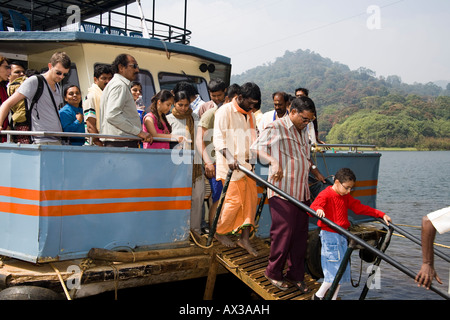 Tourists leaving pleasure boat, Periyar Lake, Periyar Wildlife Sanctuary, Thekkady, near Kumily, Kerala, India - Stock Photo