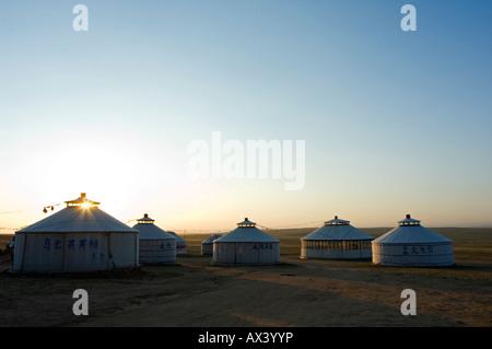China, Inner Mongolia Province, Xilamuren Grasslands. Sunrise on a nomad yurt tents. - Stock Photo