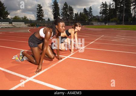Women Poised on Racetrack