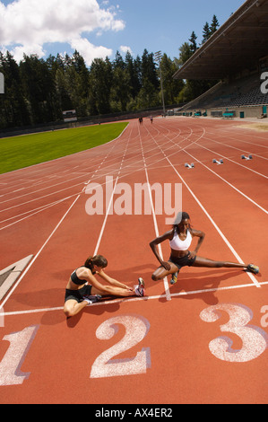 Women Stretching on Track