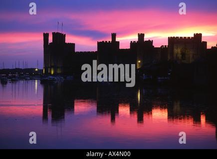 Caernarfon Castle Sunset Twilight View UNESCO World Heritage SiteNorth Wales - Stock Photo