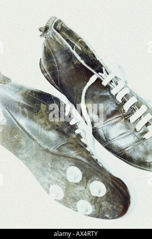Vintage black football boots photo-illustration - Stock Photo