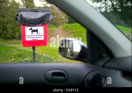 Dog foul sign seen through car window in Jersey - Stock Photo