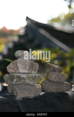 Stones piled into symbolic stacks at Bulguksa temple near Kyeongju in south east Korea - Stock Photo