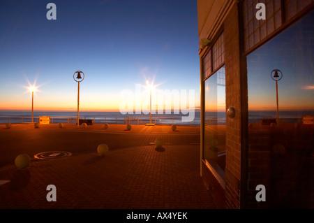 Shark Bell at Dawn reflected in The Esplanade Restaurant St Clair Beach Dunedin South Island New Zealand Stock Photo