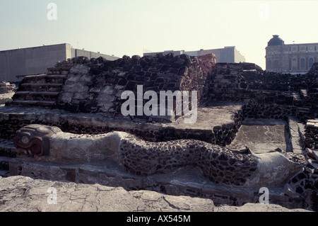Serpent sculpture and ruins of the Templo Mayor or Great Pyramid of Tenochtitlan, Mexico City - Stock Photo