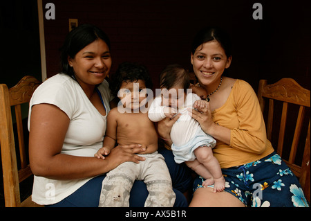 Two mothers with their children, toddler and baby, Asuncion, Paraguay, South America - Stock Photo