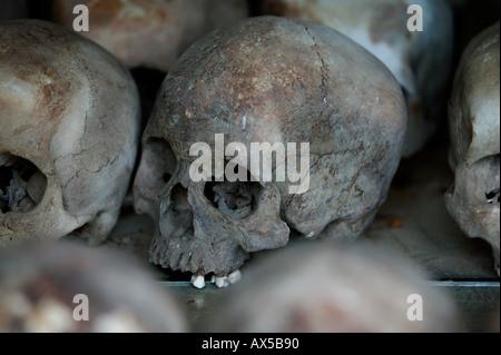 Skulls exposed in Memorial Stupa in Killing Fields of Choeung Ek 15km from central Phnom Penh Cambodia Asia - Stock Photo