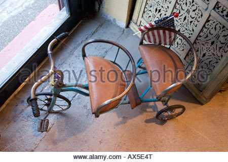 a antique twin seat tricycle with American flag - Stock Photo