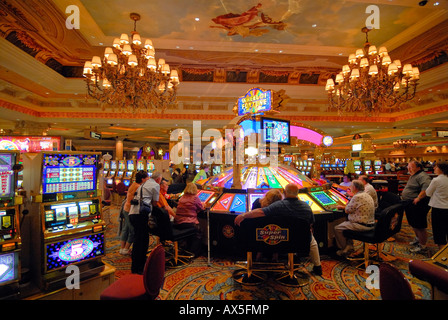 Gamblers sitting in front of slot machines at The Venetian Resort Hotel & Casino on the Strip, Las Vegas Boulevard, - Stock Photo