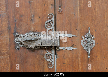 Old lock on a wooden door at the parish church in Schoengau, Triestingtal, Lower Austria, Austria - Stock Photo