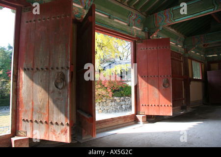 Open doors reveal autumn leaves at Bulguksa temple near Kyeongju in south east Korea - Stock Photo