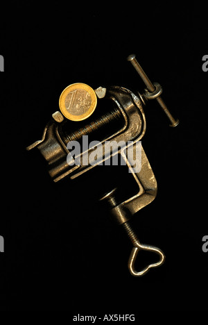 1-Euro cent in a bench vice - Stock Photo
