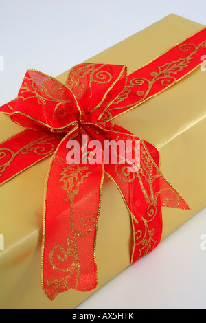 Wrapped christmas present with large red bow - Stock Photo