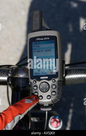 Mobile GPS unit on mountain bike handlebars, monitors showing coordinates, Samerberg, Bavaria, Germany, Europe - Stock Photo