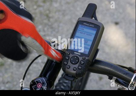 Mobile GPS unit on mountain bike handlebars, saving a position, Samerberg, Bavaria, Germany, Europe - Stock Photo