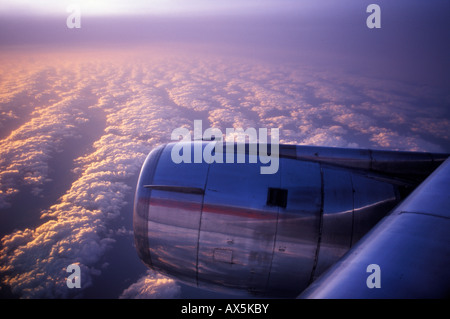 Aircraft engine viewed from the window of an airplane - Stock Photo
