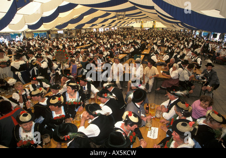 Attendees dressed in traditional costume sitting in the festival tent during the Loisachgau Festival in Egling, - Stock Photo