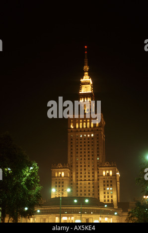 Warsaw, Poland; building from Stalin era lit up at night. - Stock Photo
