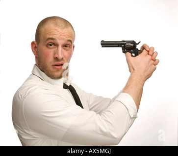 Young man holding toy gun - Stock Photo