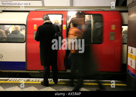 Passengers boarding a train during rush hour at Bank / Monument underground station, London, England, UK, Europe - Stock Photo