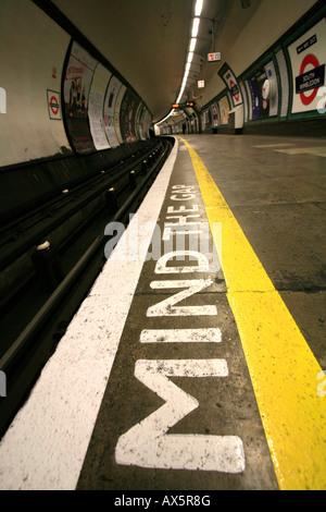 Mind the Gap - safety reminder at South Wimbledon underground station, London, England, UK, Europe - Stock Photo
